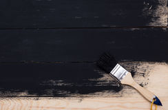Painting natural wood with paint brush Stock Photo