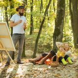 Painting in nature. Start new picture. Beauty of nature. Bearded man woman and cute son relaxing autumn nature. Drawing stock images
