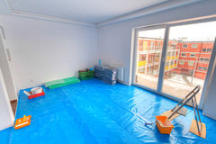 Painting of new apartment. With covered floor Royalty Free Stock Image
