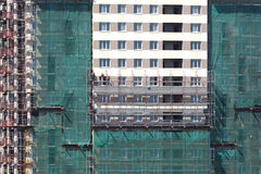 Painting of new high building with workers Stock Images