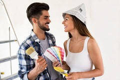 Painting new home. Couple renovating new house royalty free stock photography