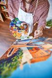 Painting with oil paints Stock Images