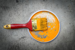 Painting  in a orange color. Paint can with  brush Stock Photography