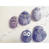 Painting owls on stones Royalty Free Stock Image