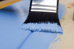 Painting with a paint brush Stock Photography