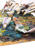 Painting palette and brushes. In focus paint brushes and blured palette for painting Stock Image