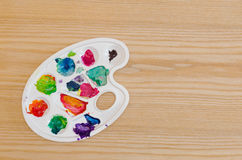 Painting palette on a wooden surface Royalty Free Stock Photo