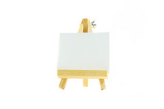 Painting paper put on easel white background. Small painting paper put on easel white background Stock Photo