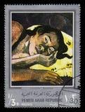 Painting by Paul Gauguin, Nevermore. Yemen - CIRCA 1968: stamp printed in Yemen Arab Republic, shows painting by Paul Gauguin, Nevermore 1897, silver frame royalty free stock images