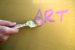 Painting. Photo montage of a hand painting the word art Stock Photo