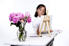 Painting a picture of flowers. Stock Photo