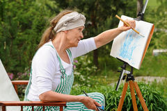 Painting pictures outdoors Stock Photo