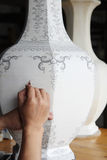 Painting in the porcelain body Stock Photos