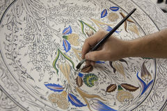 Painting of porcelain by hand. A traditional iznik Royalty Free Stock Images