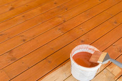 Painting the porch with pigmented oil royalty free stock photography