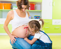 Painting on pregnant mother belly Stock Photo