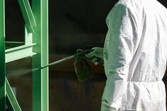 Painting process by spray gun Royalty Free Stock Image