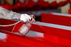 Painting process by spray gun Royalty Free Stock Photos