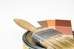 Painting project. Paintbrush and color swatches on top of can of paint Royalty Free Stock Images