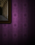 Painting on purple wall. Painting hanging on the wall with a purple retro wallpaper Royalty Free Stock Image