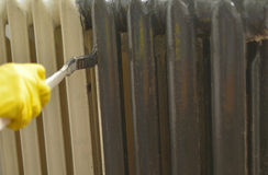 Painting a radiator Stock Photography