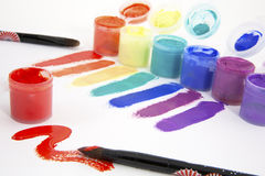 Painting with the Rainbow. Paint pots and painted stripes for all the colors of the rainbow Stock Images