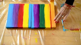 Painting rainbow on canvas, gay pride, transsexuality concept stock photo