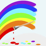 Painting rainbow colors. Royalty Free Stock Photo
