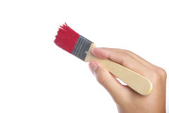 Painting with red brush. Isolated on white background Stock Image