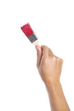 Painting with red brush. Isolated on white background Royalty Free Stock Photos