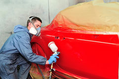 Painting red car. Royalty Free Stock Image