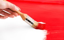 Painting with red colored ink and brush Stock Photo