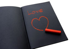 Painting a red heart. On black paper Royalty Free Stock Photography
