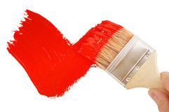 Painting red tick. Painting tick with red brush Royalty Free Stock Photos
