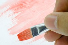 Painting with red watercolor Stock Photo