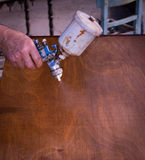 Painting restored antique wooden furniture. In carpentry royalty free stock photography