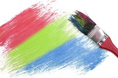 Rgb color painting. Painting rgb red, green, blue color on white paper with paint brush for use background stock photography