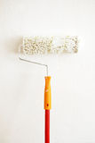 Painting roller. Paint roller on a wall Royalty Free Stock Images