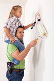Painting the room with dad Stock Photography