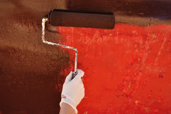 Painting Sailboat Hull with a Roller Stock Photography