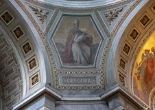 Painting of Saint Gregorius protected by netting inside the Esztergom Basilica, Esztergorm, Hungary. Pictured is a painting of Saint Gregorius protected by stock photos