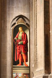 Painting San Giuliano by Francesco Botticini and Jacopo del Sellaio in Orsanmichele Church, Florence, Italy. Stock Images