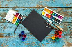 Painting set: brushes, paints, crayons, watercolor, black paper Royalty Free Stock Images