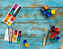 Painting set: brushes, paints, crayons, watercolor with copyspac Stock Photos