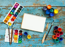 Painting set: brushes, paints, crayons, watercolor, white paper Royalty Free Stock Image