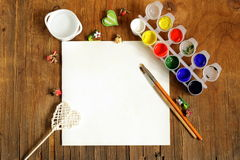 Painting set - brushes, paints (gouache). On old wooden table stock image