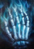 Painting skeleton hand, on black background. Airbrush painting. Royalty Free Stock Photos