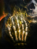 Painting  skull and skeleton hand, on black background and ornamental mandala. Airbrush painting. Royalty Free Stock Photos