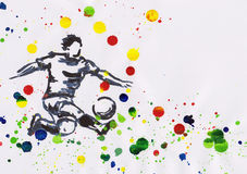 Painting of soccer player in action with paint splashes Stock Images