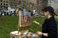 Painting of South Church. Boston, Massachusetts USA - April 28 2013 - Women with easel paints a picture of Old South Church which stands across the street Royalty Free Stock Image
